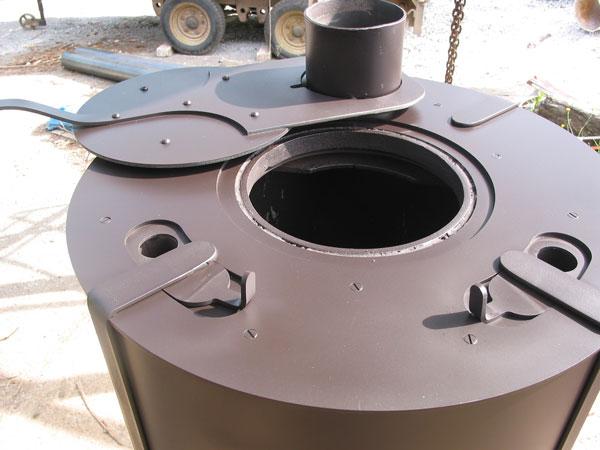 Sawdust burner prototype and model mark john churchill