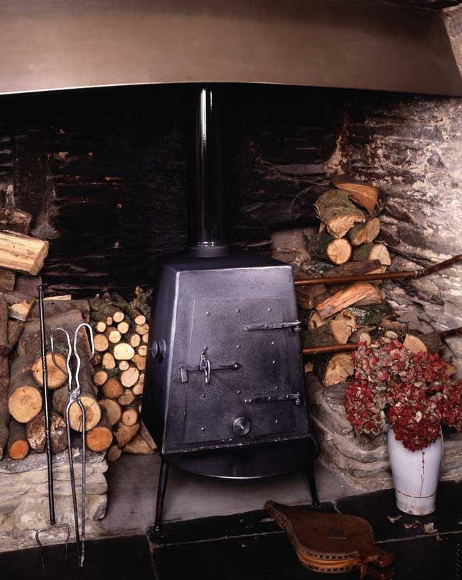 Three legged wood burner. (1988)